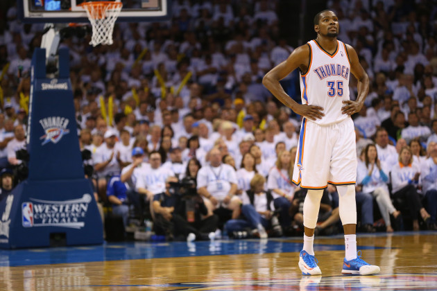 OKLAHOMA CITY, OK - MAY 31:  Kevin Durant #35 of the Oklahoma City Thunder waits on the court in the second half against the San Antonio Spurs during Game Six of the Western Conference Finals of the 2014 NBA Playoffs at Chesapeake Energy Arena on May 31, 2014 in Oklahoma City, Oklahoma. NOTE TO USER: User expressly acknowledges and agrees that, by downloading and or using this photograph, User is consenting to the terms and conditions of the Getty Images License Agreement.  (Photo by Ronald Martinez/Getty Images)