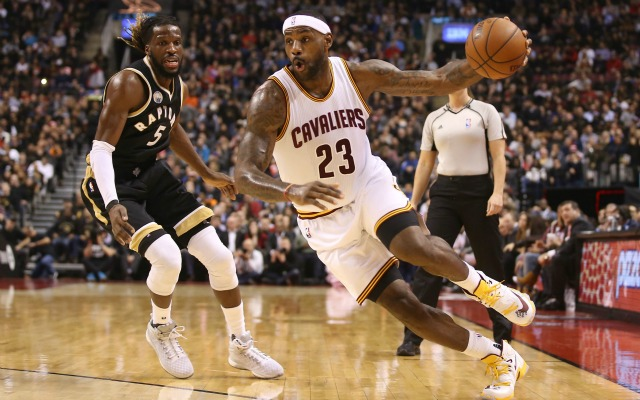 Nov 25, 2015; Toronto, Ontario, CAN; Cleveland Cavaliers forward LeBron James (23) goes to the basket past Toronto Raptors forward DeMarre Carroll (5) at Air Canada Centre. Mandatory Credit: Tom Szczerbowski-USA TODAY Sports